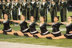 Members of the color guard perform at the first home football game in August.  This was the first year many members performed in front of an audience. Photo by Kaia Kimble