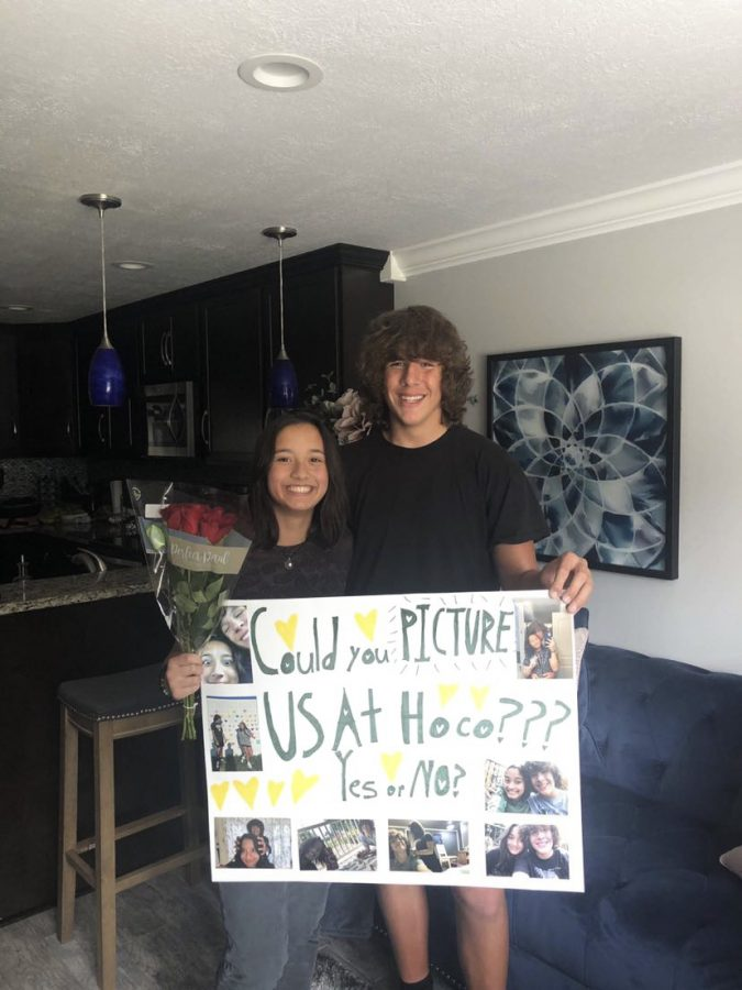Sophomore Ashton Rulewicz shows his successful homecoming proposal to sophomore Maya Bautista.