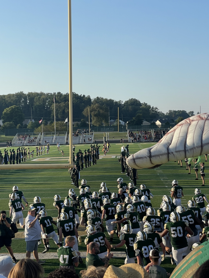 GlenOak football team faces Shaker Heights during the first football game of the season with a full crowd present. Students have had to get used to performing and playing in front of crowds after a year and a half of limited attendance.
